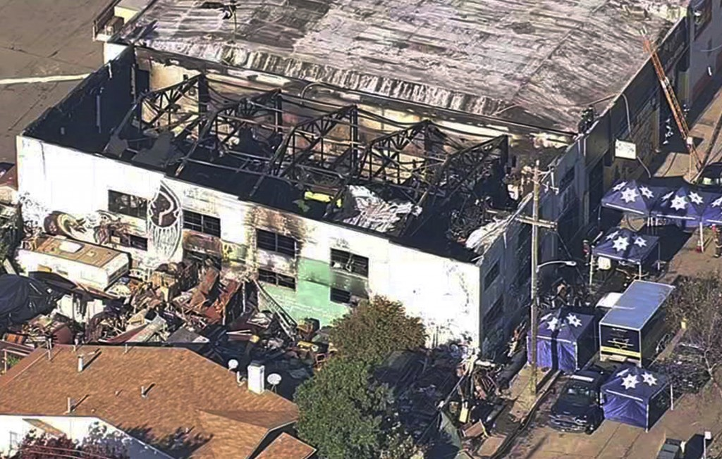 FILE - This Dec. 3, 2016 file image from video provided by KGO-TV shows the Ghost Ship Warehouse after a fire swept through the Oakland, Calif., build...