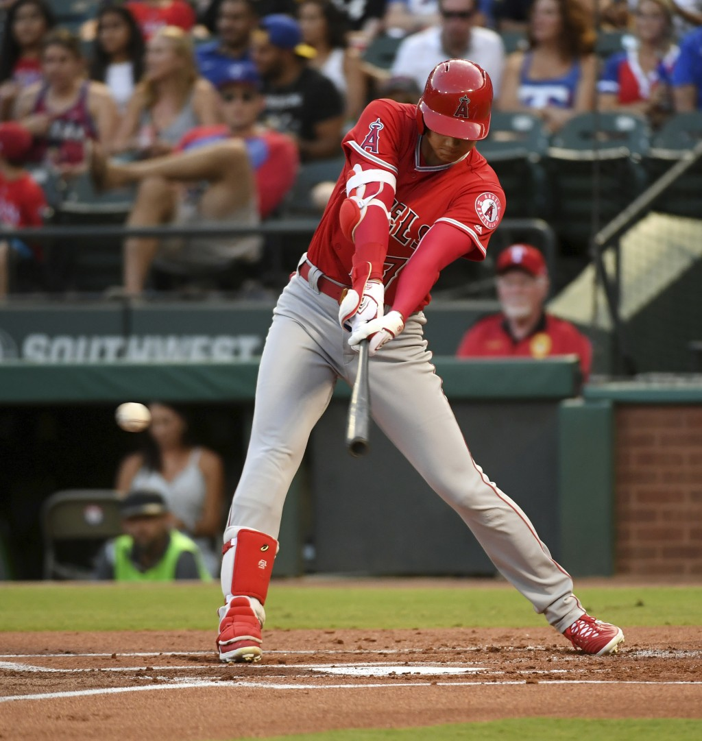 Los Angeles Angels designated hitter Shohei Ohtani connects on an RBI single off Texas Rangers starting pitcher Ariel Jurado during the first inning o...