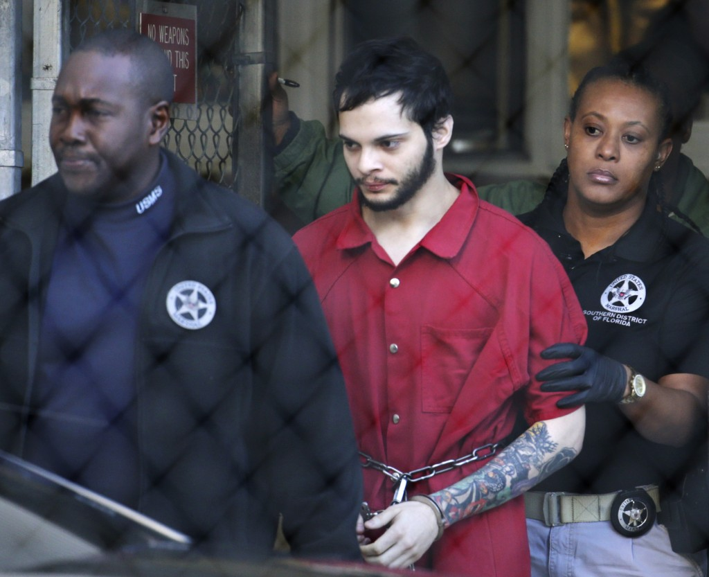 FILE - In this Jan. 30, 2017, file photo, Esteban Santiago, center, is led from the Broward County jail for an arraignment in federal court in Fort La...