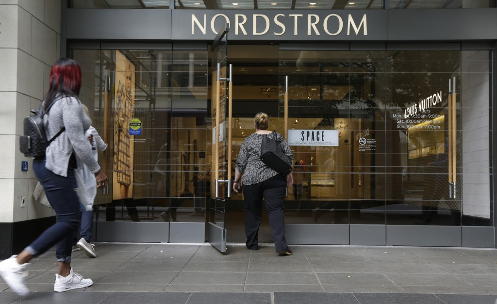 FILE- In this Sept. 13, 2017, photo, shoppers enter Nordstrom's flagship store in downtown Seattle. Nordstrom Inc. reported a 47 percent jump in secon...