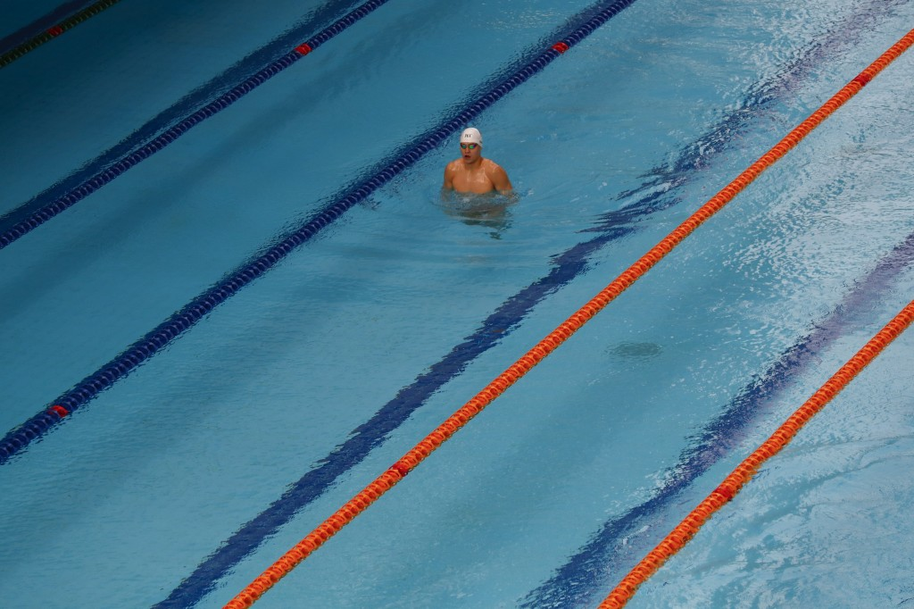 China's Sun Yang swims during a training session at the 18th Asian Games in Jakarta, Indonesia, Friday, Aug. 17, 2018. (AP Photo/Bernat Armangue)
