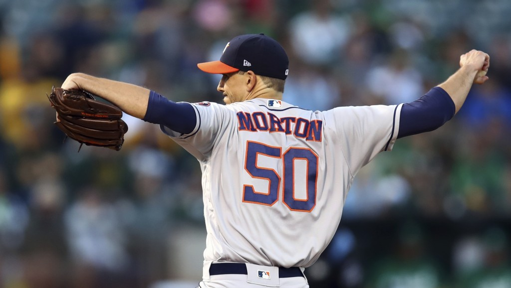 Houston Astros pitcher Charlie Morton works against the Oakland Athletics in the first inning of a baseball game Friday, Aug. 17, 2018, in Oakland, Ca...