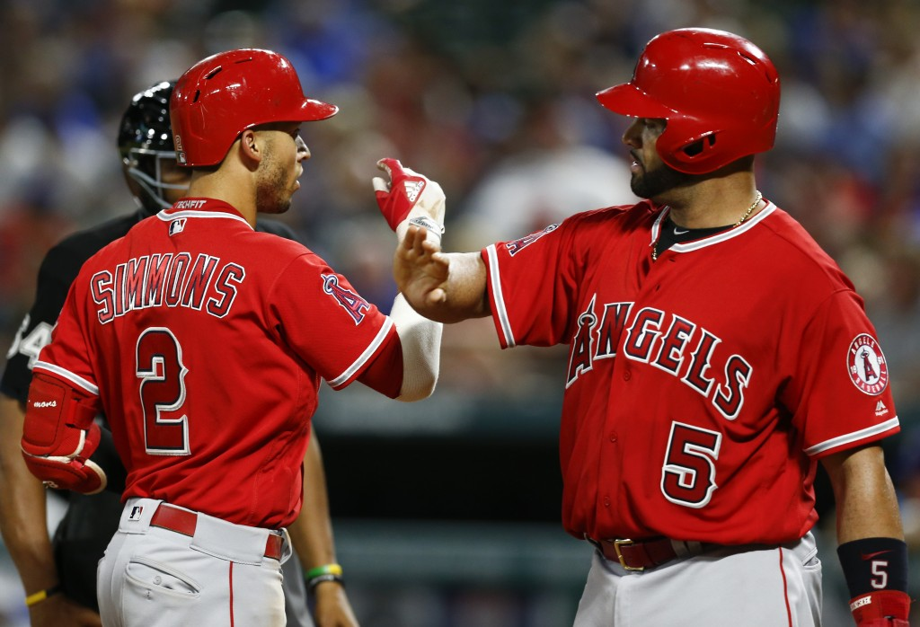 Los Angeles Angels' Andrelton Simmons (2) is congratulated by Albert Pujols (5) on his two-run home run against the Texas Rangers during the sixth inn...