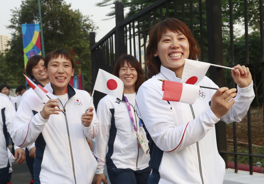 Japan's contingent prepare prior the opening ceremony for the 18th Asian Games in Jakarta, Indonesia, Saturday, Aug. 18, 2018. (AP Photo/Tatan Syuflan...