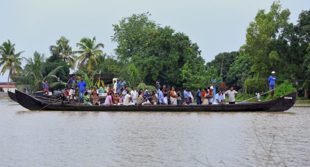 People wait to be rescued in a country boat in a flooded area at Kainakary in Alappuzha district, Kerala state, India, Friday, Aug. 17, 2018. Rescuers...