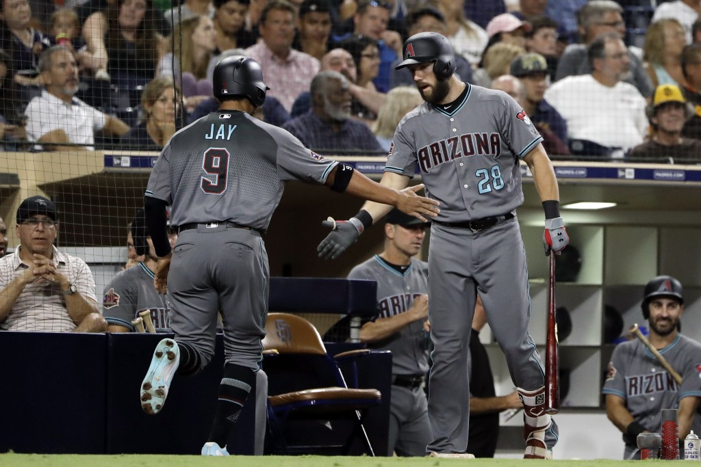 Arizona Diamondbacks' Jon Jay (9) is greeted by Steven Souza Jr. after scoring during the fourth inning of a baseball game against the San Diego Padre...