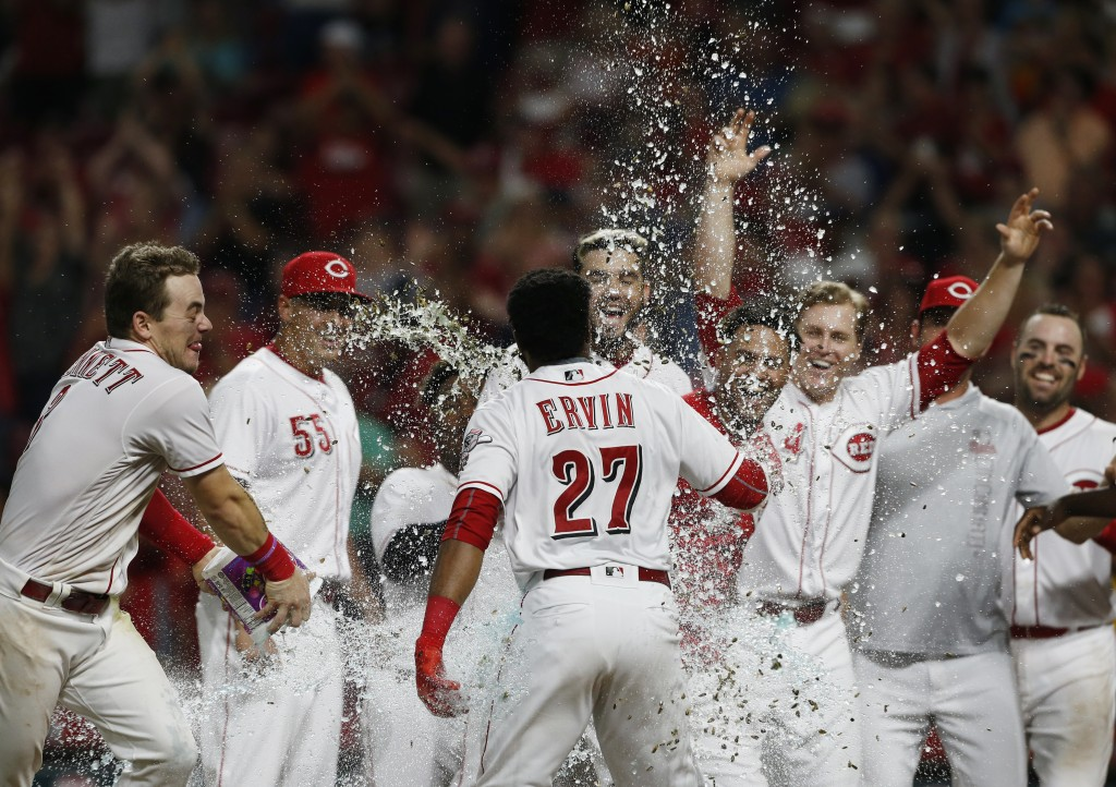 Cincinnati Reds' Phillip Ervin (27) is sprayed with water as he crosses home plate with a walk-off home run off San Francisco Giants relief pitcher Ra...