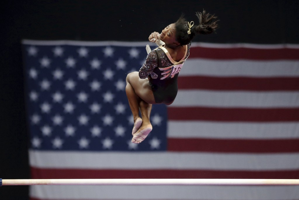 Simone Biles competes on the uneven bars at the U.S. Gymnastics Championships, Friday, Aug. 17, 2018, in Boston. (AP Photo/Elise Amendola)