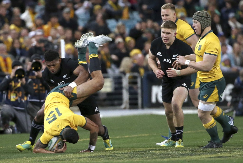Australia's Israel Folau is dumped by New Zealand's Waisake Naholo during their rugby union test match in Sydney Saturday Aug. 18 2018. (AP
