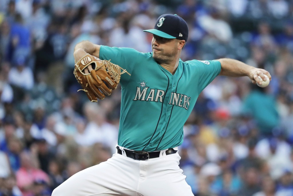 Seattle Mariners starting pitcher Wade LeBlanc throws to a Los Angeles Dodgers batter during the first inning of a baseball game Friday, Aug. 17, 2018...