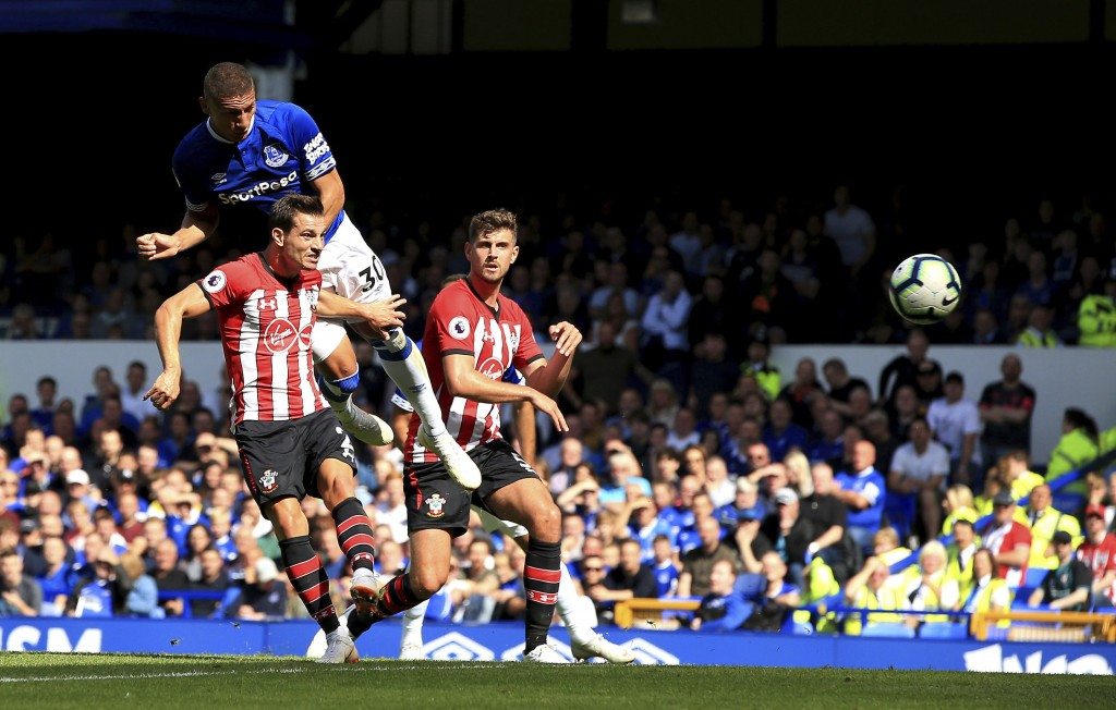 Everton's Richarlison, top left, scores his side's second goal of the game against Southampton during their English Premier League soccer match at Goo...