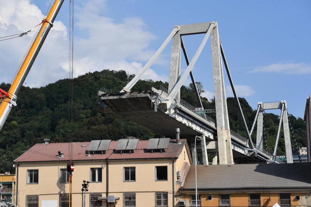 A view of the collapsed Morandi highway bridge, in Genoa, Italy, Friday, Aug. 17, 2018. Officials say 38 people are confirmed killed and 15 injured. P...