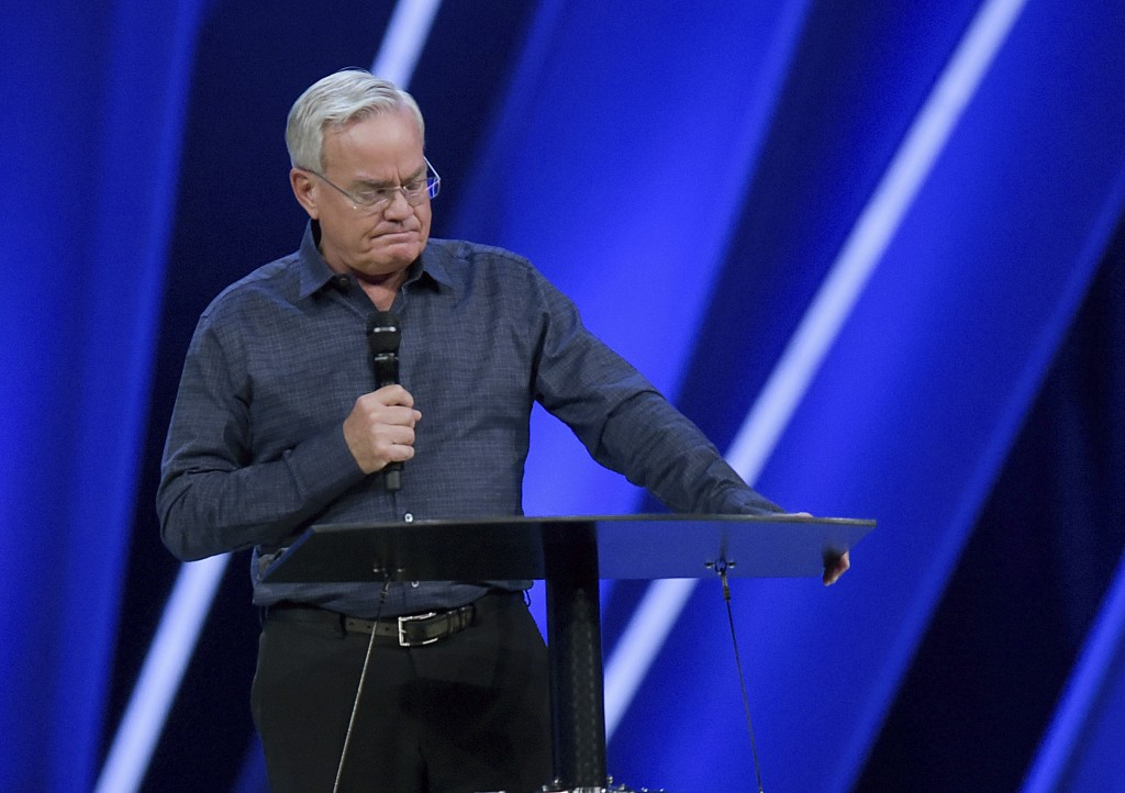 FILE - In this Tuesday, April 10, 2018 file photo, Willow Creek Community Church Senior Pastor Bill Hybels stands before his congregation in South Bar...