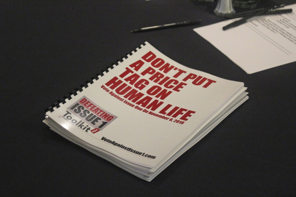 "In this July 26, 2018 photo, an information booklet about a ""tort reform"" measure appearing on Arkansas' ballot sits on a table at a breakfast meeting..."