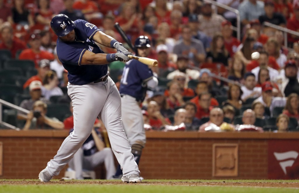 Milwaukee Brewers' Jesus Aguilar hits a two-run single during the eighth inning of a baseball game against the St. Louis Cardinals on Friday, Aug. 17,...