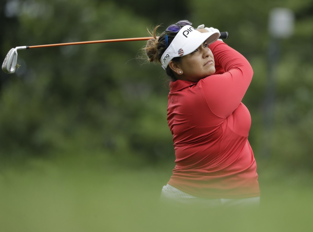 Lizette Salas watches her tee shot on the seventh hole during the second round of the Indy Women in Tech Championship golf tournament, Friday, Aug. 17...