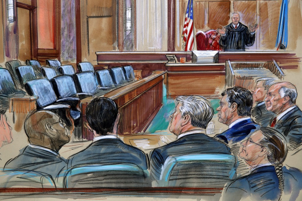 This courtroom sketch depicts U.S. District court Judge T.S. Ellis III speaking to the lawyers and defendant Paul Manafort, fourth from left, as the j...