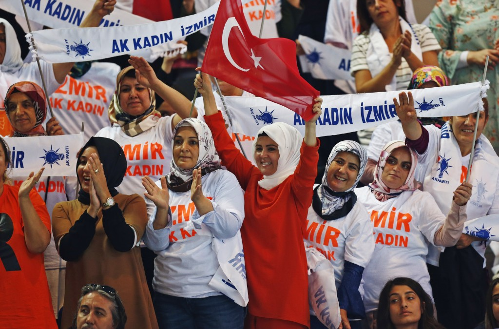 Supporters of Turkey's President Recep Tayyip Erdogan, cheer as he arrives to deliver a speech at his ruling Justice and Development Party (AKP) congr...