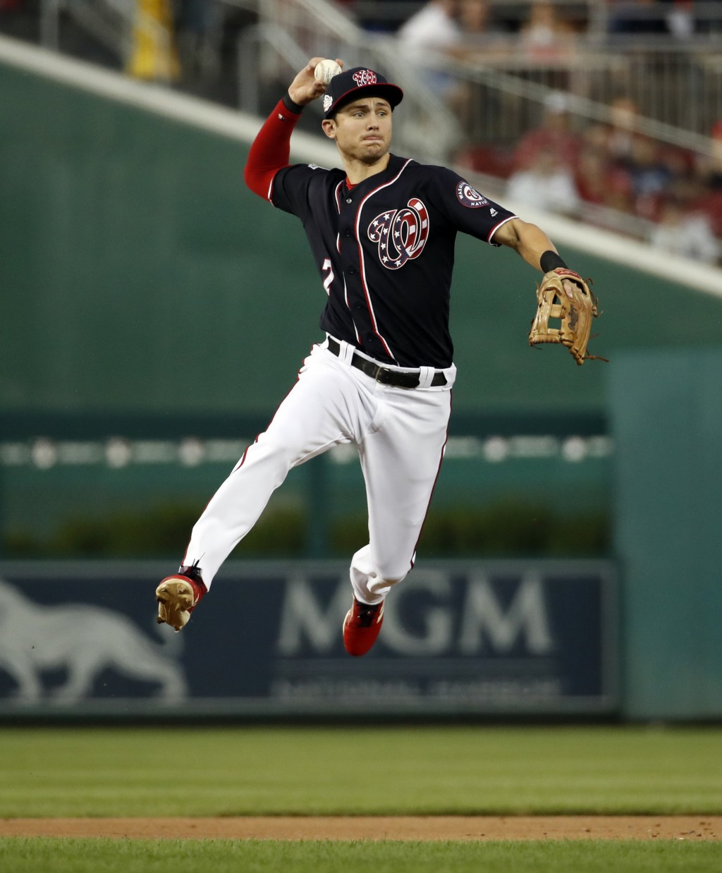 Washington Nationals shortstop Trea Turner jumps to throw out Miami Marlins' J.T. Realmuto during the first inning of a baseball game at Nationals Par...