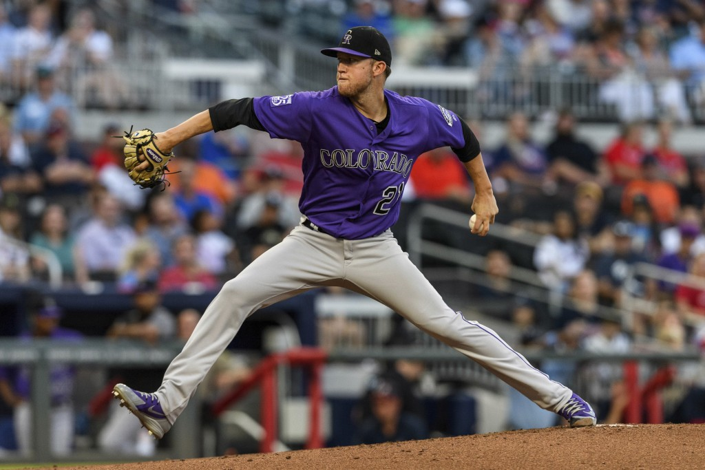 Colorado Rockies starting pitcher Kyle Freeland works against the Atlanta Braves during the first inning of a baseball game in Atlanta, Friday, Aug. 1...