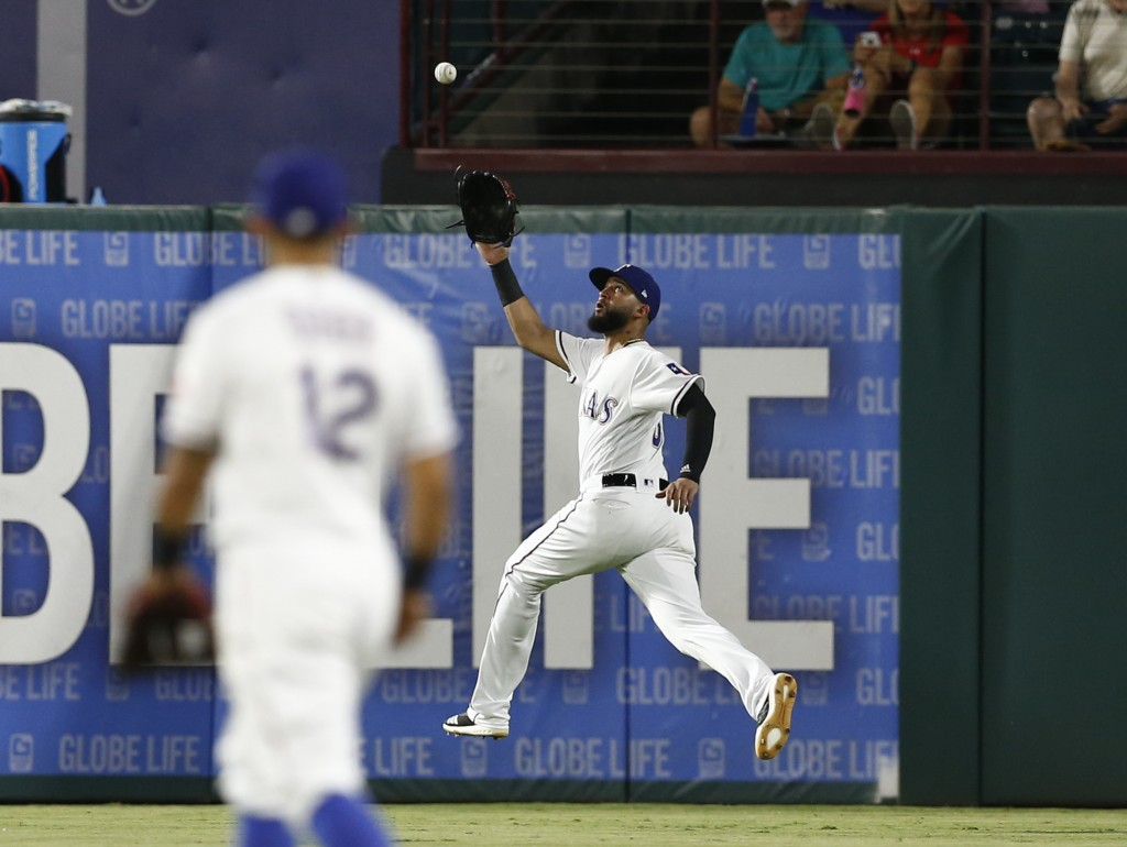 Texas Rangers right fielder Nomar Mazara chases down a fly-out hit by Los Angeles Angels' Taylor Ward during the fifth inning of a baseball game, Frid...