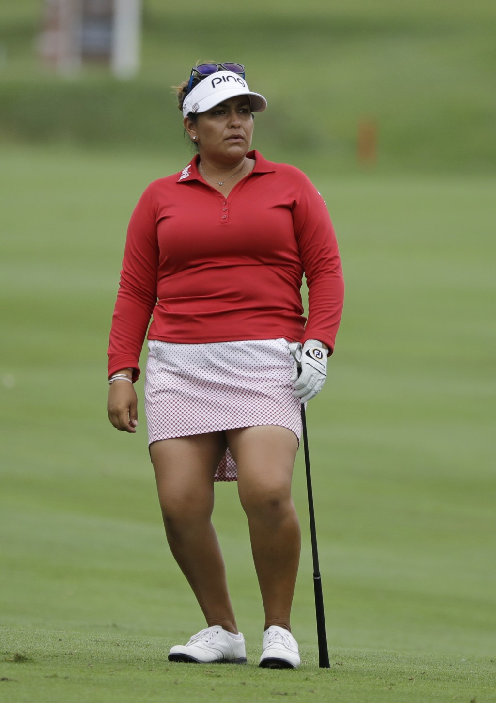 Lizette Salas watches her shot into the sixth green during the second round of the Indy Women in Tech Championship golf tournament, Friday, Aug. 17, 2...