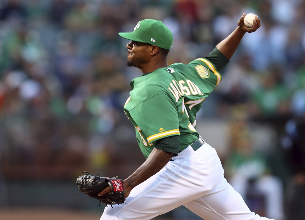 Oakland Athletics pitcher Edwin Jackson works against the Houston Astros in the first inning of a baseball game Friday, Aug. 17, 2018, in Oakland, Cal...