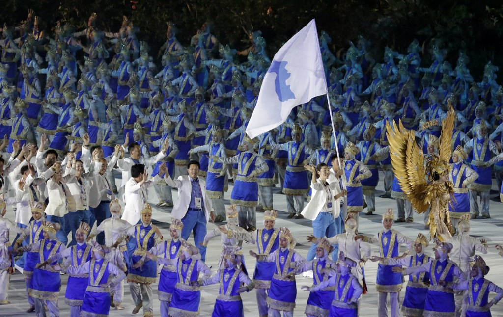 """The combined Koreas march into Gelora Bung Karno Stadium under the """"unification"""" flag during the opening ceremony for the 18th Asian Games in Jakarta,..."""