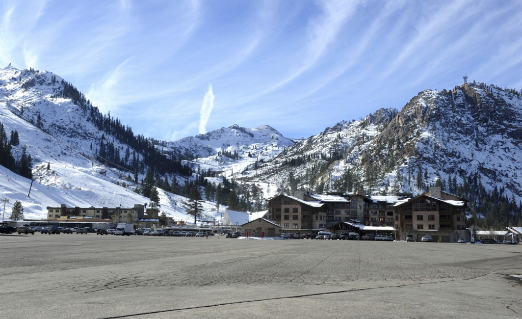 FILE - This Dec. 16, 2013 file photo, shows the expansive parking lot at the base village at Squaw Valley in Olympic Valley, Calif. Environmentalists ...
