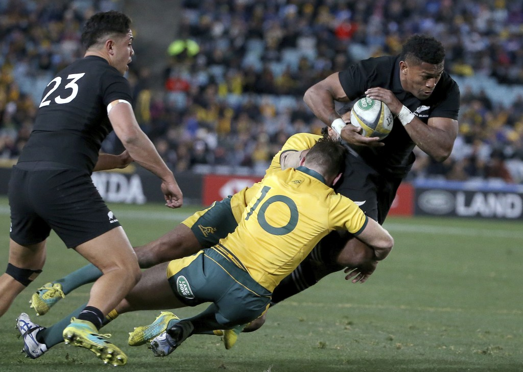 New Zealand's Waisake Naholo, right, is brought down by Australia's Bernard Foley during their rugby union test match in Sydney, Saturday, Aug. 18, 20...