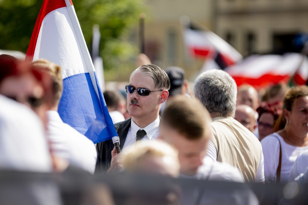 A man attends a demonstration commemorating the 31st death anniversary Hitler's deputy Rudolf Hess in Berlin Saturday, Aug 18, 2018. Hess died 1987 in...