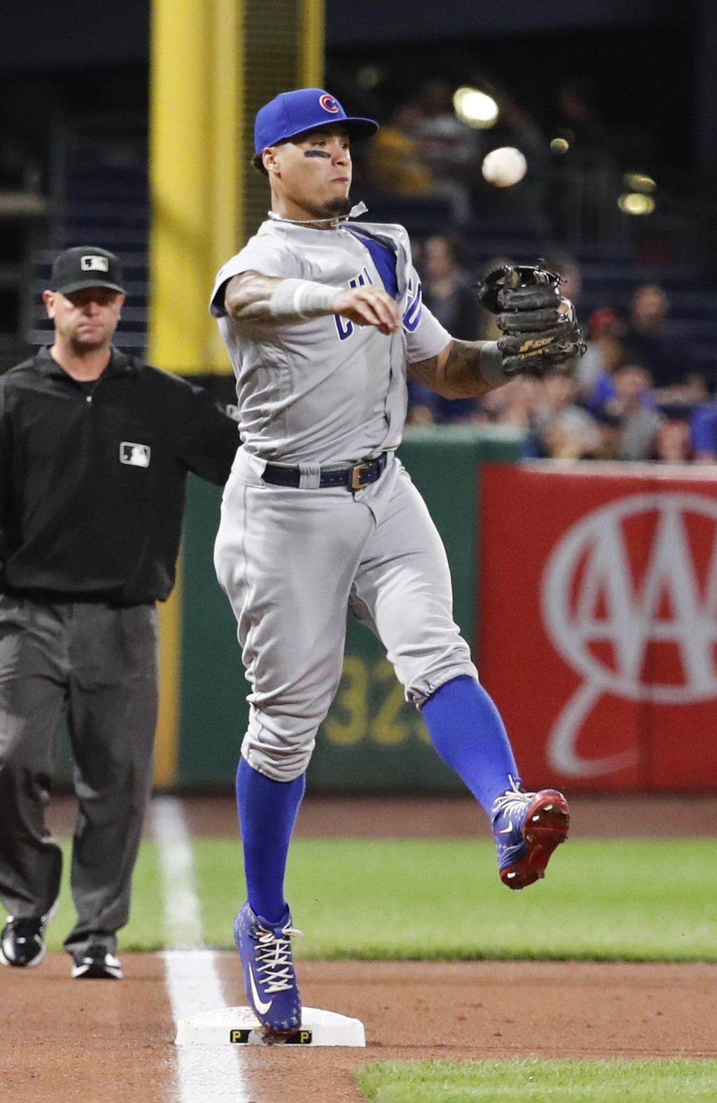 Chicago Cubs third baseman Javier Baez throws to first to complete a double play on Pittsburgh Pirates' David Freese after forcing out Starling Marte ...