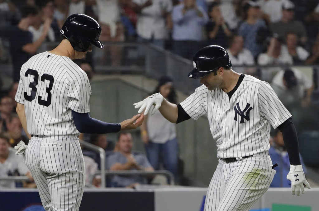 New York Yankees' Neil Walker, right, celebrates with teammate Greg Bird after they scored on Walker's three-run home run during the fourth inning of ...