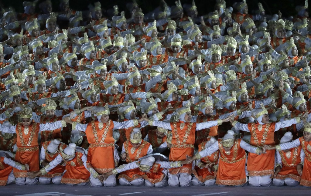 Dancers perform during the opening ceremony for the 18th Asian Games in the Gelora Bung Karno Stadium, Jakarta, Indonesia, Saturday, Aug. 18, 2018. (A...