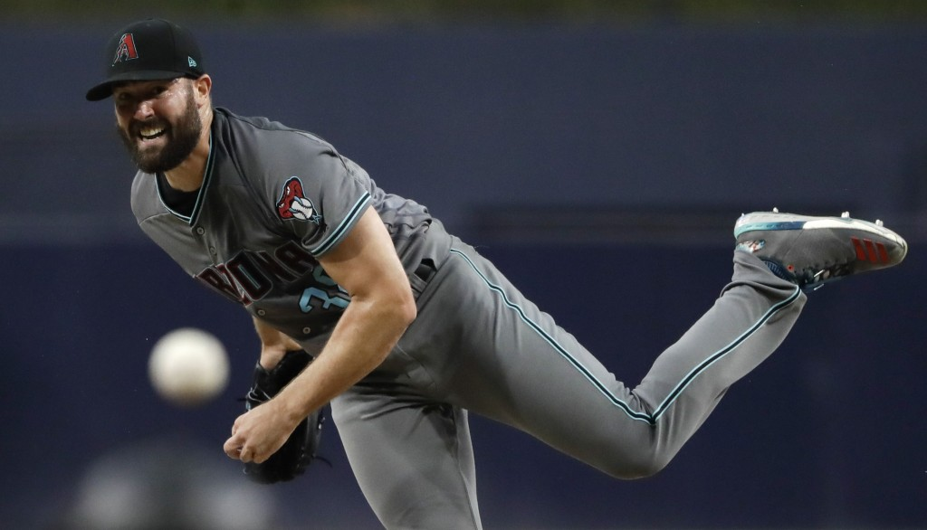 Arizona Diamondbacks starting pitcher Robbie Ray works against a San Diego Padres batter during the first inning of a baseball game Friday, Aug. 17, 2...