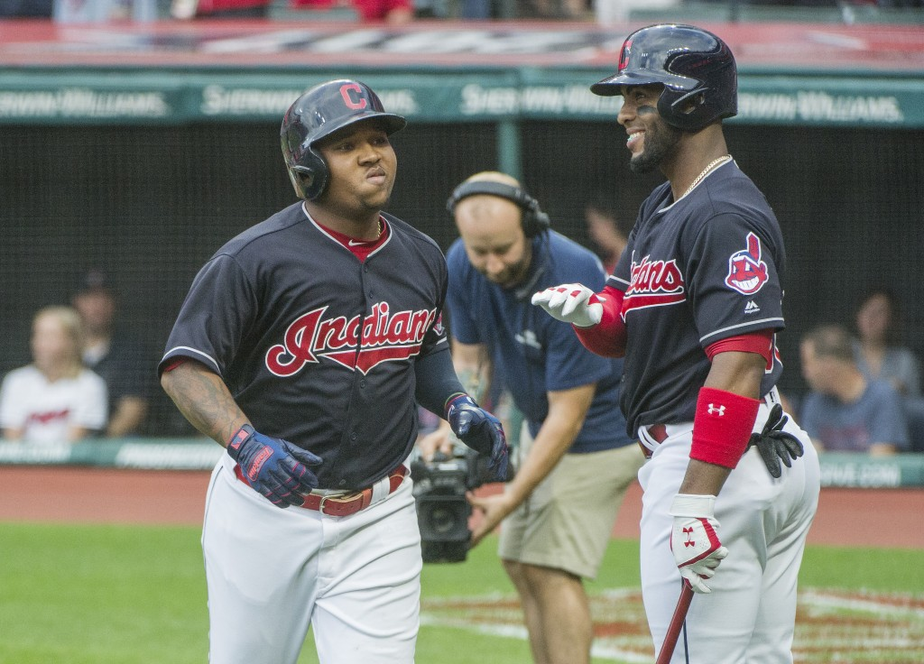 Cleveland Indians' Jose Ramirez is greeted by Yandy Diaz after hitting a two-run home run off Baltimore Orioles starting pitcher David Hess during the...