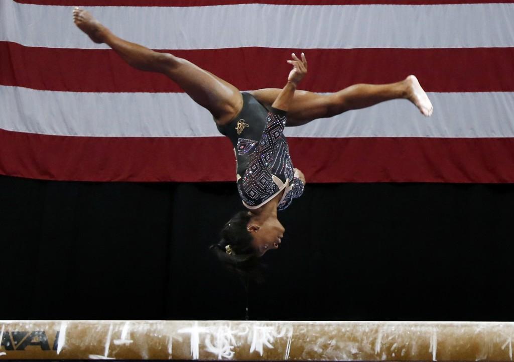 Simone Biles competes on the balance beam at the U.S. Gymnastics Championships, Friday, Aug. 17, 2018, in Boston. (AP Photo/Elise Amendola)