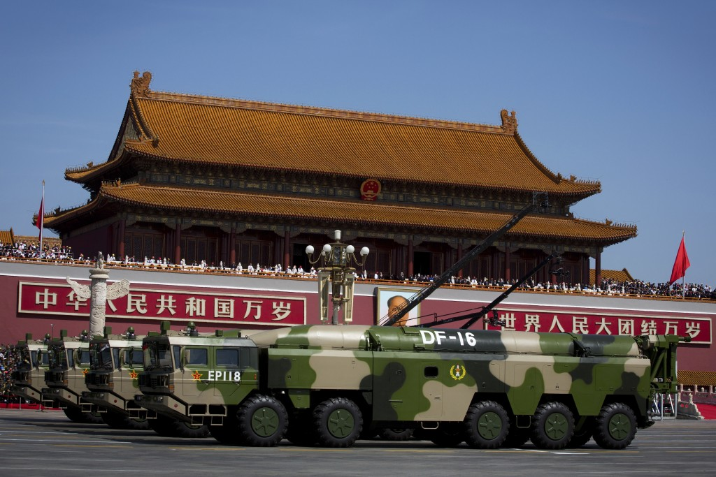 FILE - In this Sept. 3, 2015, file photo, military vehicles carry DF-16 short-range ballistic missiles past Tiananmen Gate during a military parade to...
