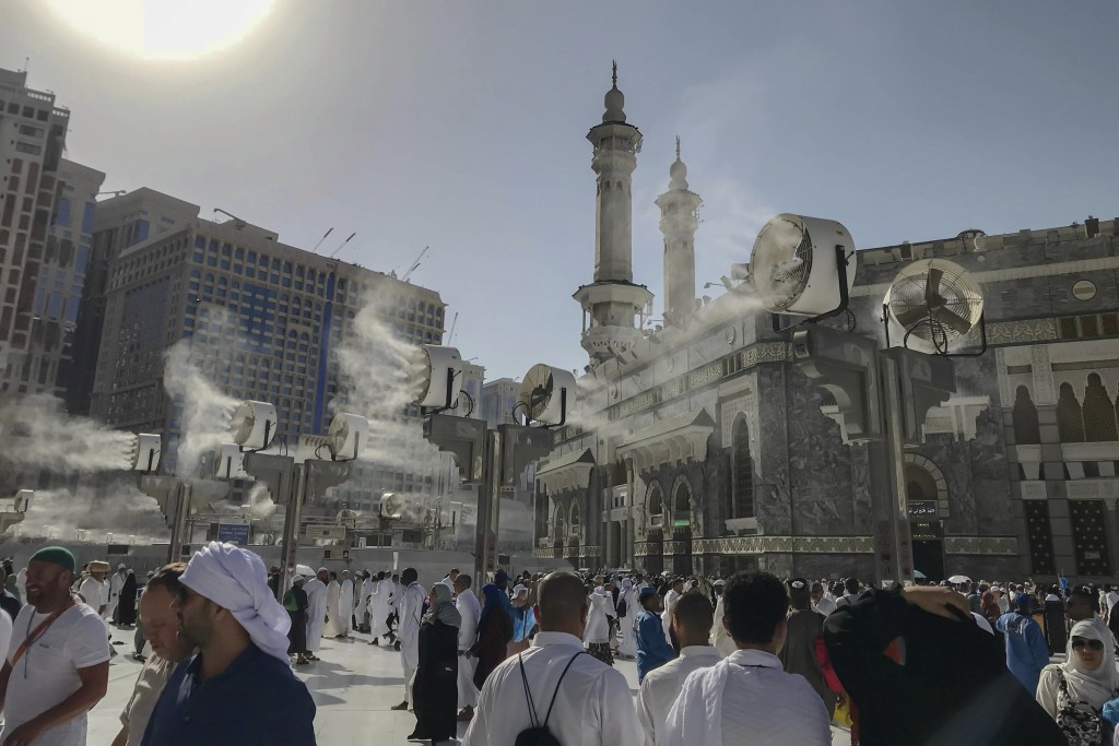 Large cooling fans spray water on Muslim pilgrims around the Grand Mosque ahead of the annual Hajj pilgrimage in the Muslim holy city of Mecca, Saudi ...