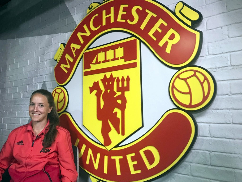 Man United women's team manager Casey Stoney smiles during an interview with the Associated Press at Manchester United's AON Training Complex in Manch...