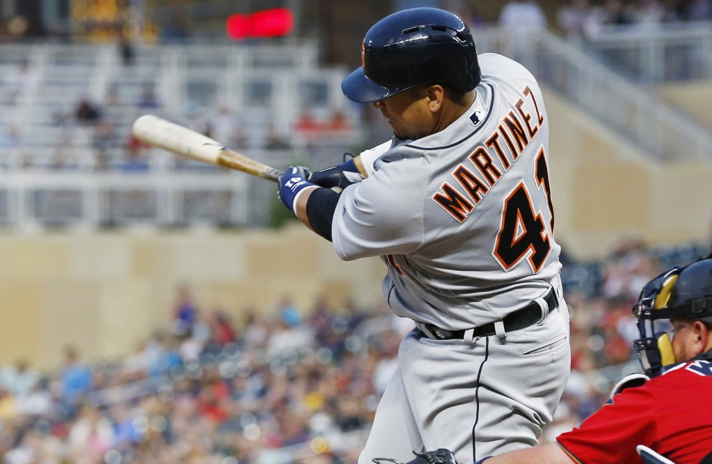 Detroit Tigers' Victor Martinez hits an RBI-single off Minnesota Twins pitcher Kyle Gibson in the fourth inning of a baseball game Friday, Aug. 17, 20...