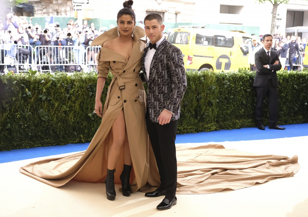 FILE - In this May 1, 2017 file photo, Priyanka Chopra, left, and Nick Jonas attend The Metropolitan Museum of Art's Costume Institute benefit gala ce...