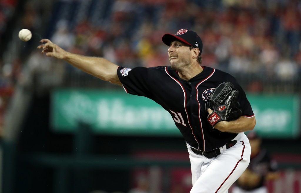 Washington Nationals starting pitcher Max Scherzer throws during the first inning of the team's baseball game against the Miami Marlins at Nationals P...