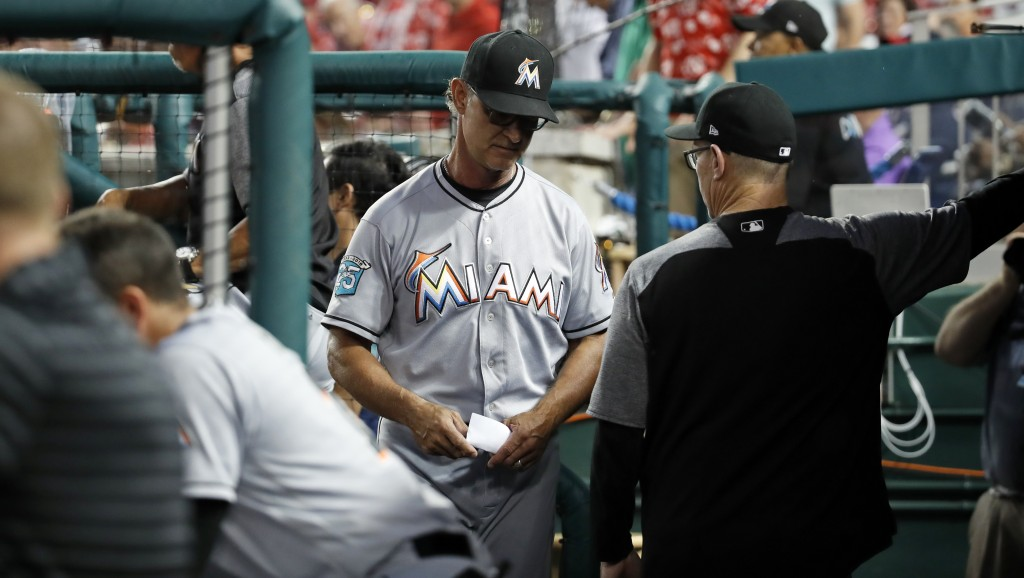 Miami Marlins manager Don Mattingly, center, heads to the clubhouse after he was ejected during the fourth inning of the team's baseball game against ...