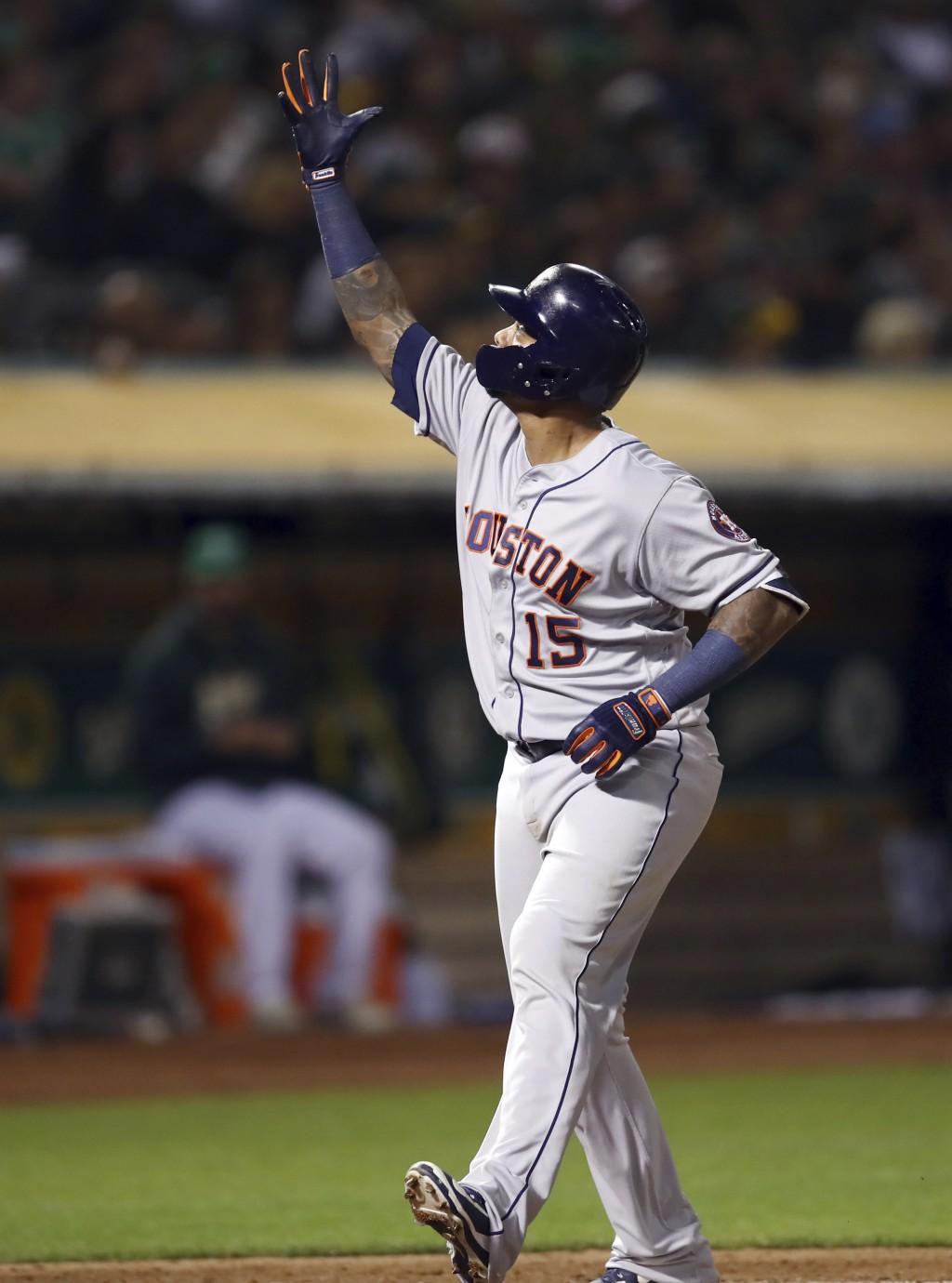 Houston Astros' Martin Maldonado celebrates after hitting a home run off Oakland Athletics' Edwin Jackson in the fifth inning of a baseball game Frida...