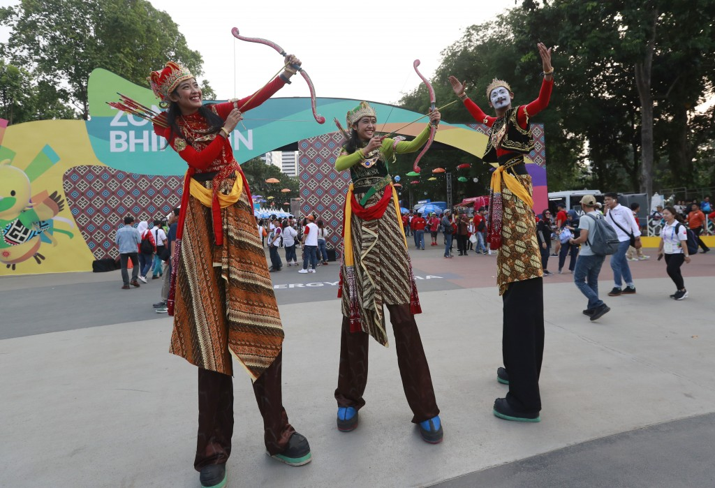 Indonesia's perform on stilts prior the opening ceremony for the 18th Asian Games in Jakarta, Indonesia, Saturday, Aug. 18, 2018. (AP Photo/Tatan Syuf...