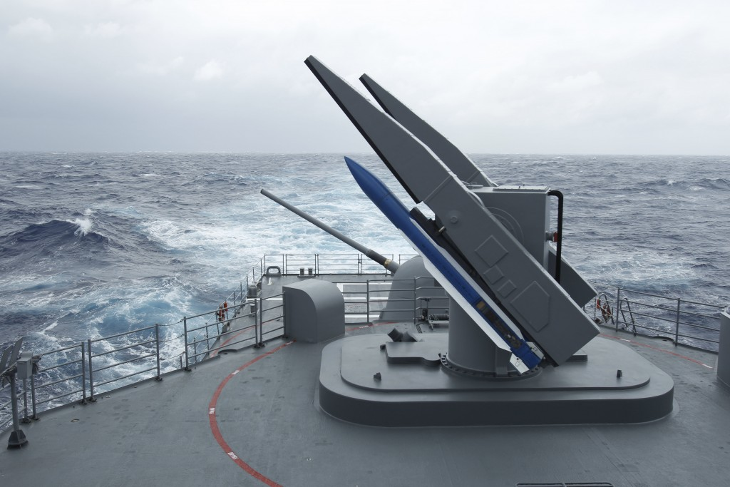 FILE - In this Sept. 26, 2013, file photo, Taiwan's navy practices loading surface-to-air SM-2 missiles from a Kidd class destroyer during the Hai-Bia...