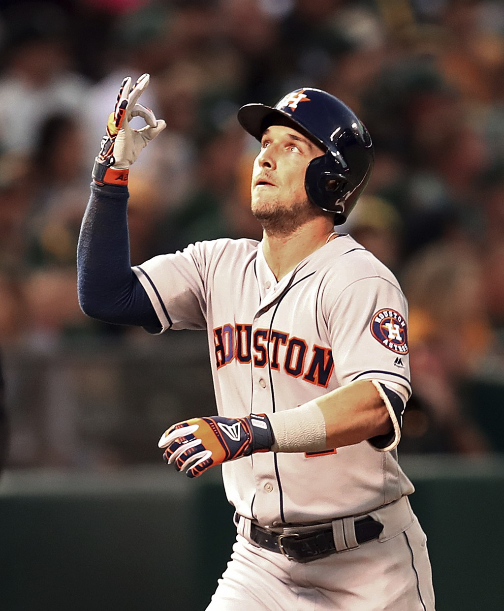 Houston Astros' Alex Bregman celebrates after hitting a home run off Oakland Athletics' Edwin Jackson in the fourth inning of a baseball game Friday, ...