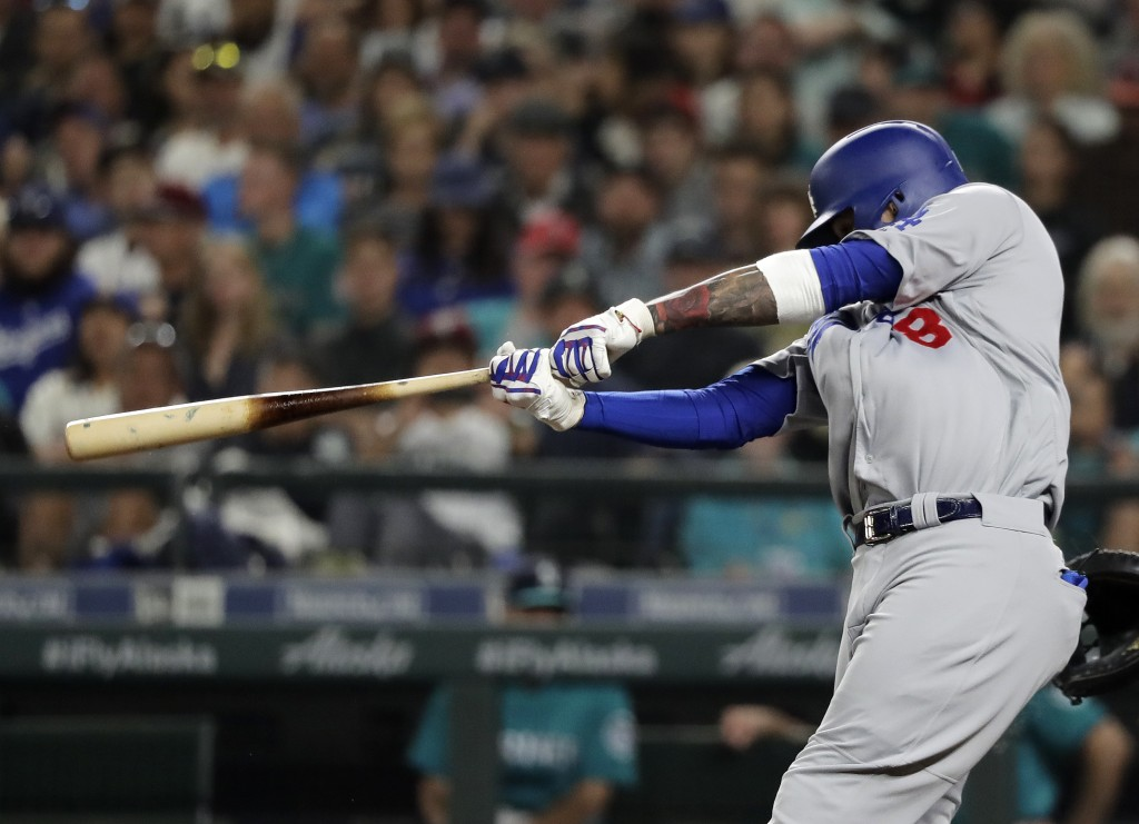 Los Angeles Dodgers' Manny Machado hits a two-run home run during the seventh inning of the team's baseball game against the Seattle Mariners, Friday,...
