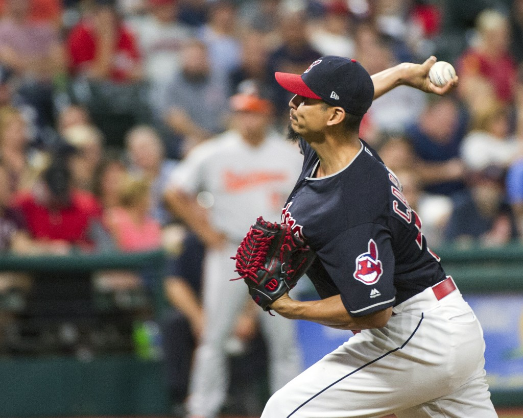 Cleveland Indians starting pitcher Carlos Carrasco delivers to Baltimore Orioles' Tim Beckham during the seventh inning of a baseball game in Clevelan...